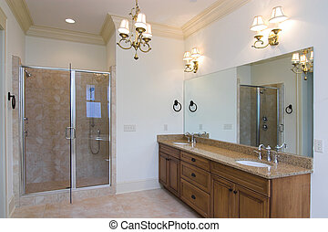 spacious bathroom with glass shower