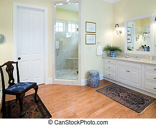 bathroom vanity with mirror and wood chair