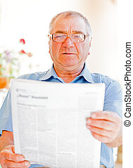 Elderly home care - Elderly man read newspaper on the...