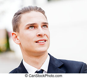 Young businessman - Portrait of young businessman thinking...