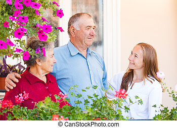 Happy elderly couple talking with the therapist