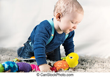 A little boy at play - Little boy playing with their...