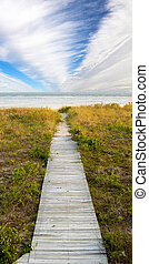 boardwalk and sky - boardwalk leading to beach with dramatic...