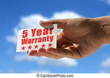 card with five year warranty inscription - business card...