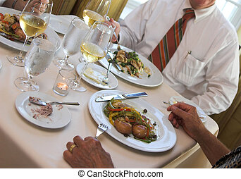 business dinner - table of food at restaurant with people...
