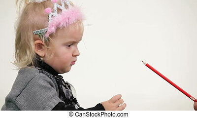 Little princess playing with pencils