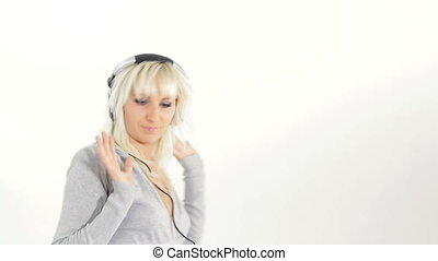 Listening to music - Young woman listening music in...