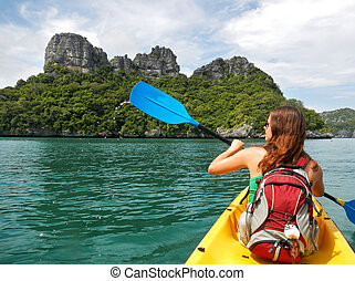 Young woman kayaking in Ang Thong National Marine Park,...