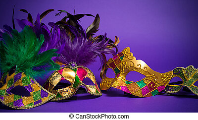 Assorted Mardi Gras or Carnivale mask on a purple background...