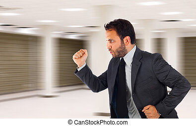 Businessman running in office because it is late - Young...