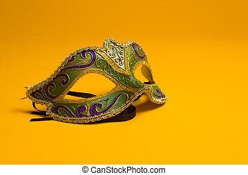 Green and gold Mardi Gras, venetian mask on Yellow...