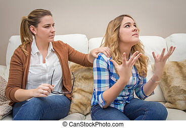 Furious mother arguing with her ??teenage daughter - Furious...