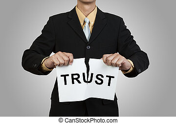 Businessman tear paper with word Trust on gray background
