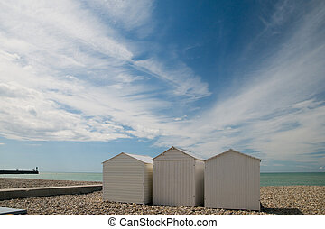 Beach cabins - White beach cabins at the Normandy coast near...
