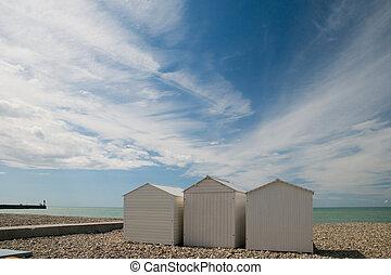 Beach cabins - White beach cabins at the Normandy coast near...