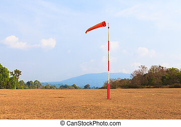 Airport flagpole on ground field - Airport flagpole