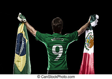 Mexican soccer player, celebrating on the black backgrond.