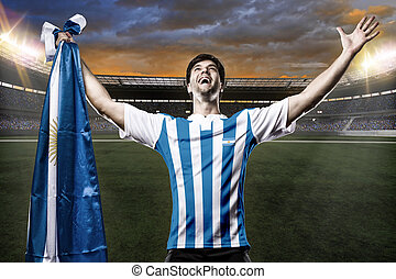 Argentinian soccer player, celebrating with the fans.