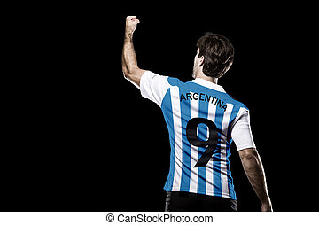 Argentinian soccer player, celebrating on the black...