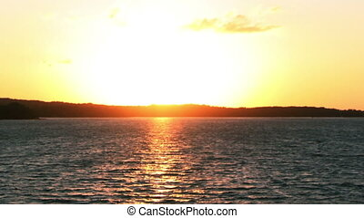 Sunset over a lake time lapse - Time lapse of a beautiful...