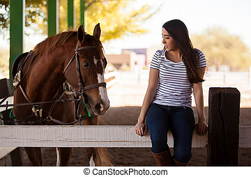 Keeping my horse some company - Cute girl spending some time...