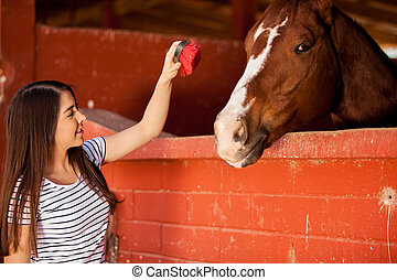 Let me brush your hair - Equine Therapy patient interacting...
