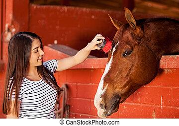 How does that feel buddy - Cute Hispanic woman brushing a...