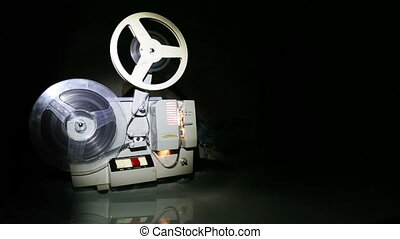 old projector showing film on screen - dolly shot
