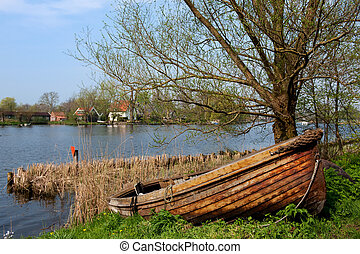 River with wooden sloop - River in Holland with wooden sloop