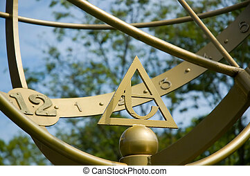 Sundial - An old-fashioned sundial around 12 \'o-clock