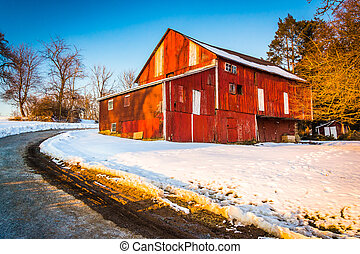 Red barn during the winter in rural York County,...