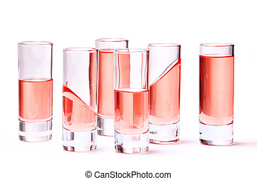 Thin glasses with pink liquid on white background