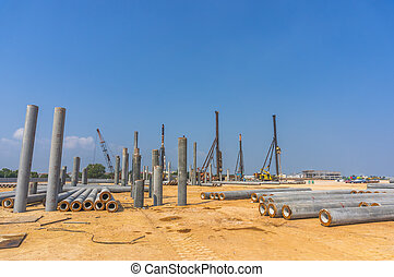 Piling work at construction site with blue skies background