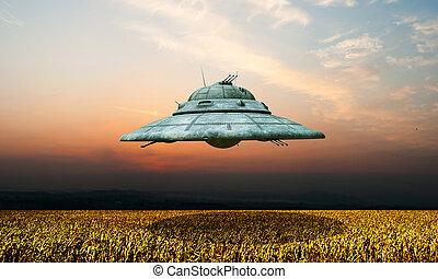 nazi ufo Haunebu flying over a wheat field