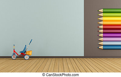 Playroom with big colorful pencils on wall and tricycle -...