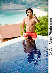 Relaxing On Vacation - A young Chinese guy in pool with...