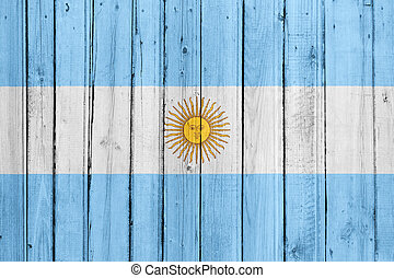The Argentine flag painted on a wooden fence