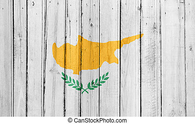 The Cypriot flag painted on a wooden fence