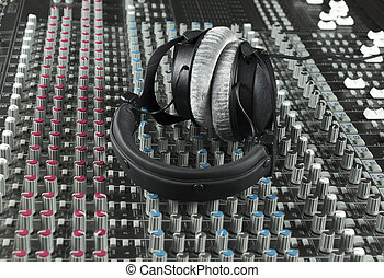 Headphone on a studio mixer - Headphone closeup Series...
