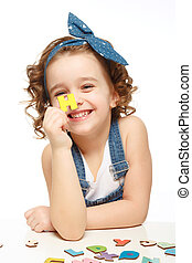 Little girl playing in the alphabet. Shows the letter H. -...