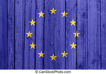 The European Union Flag painted on a wooden fence