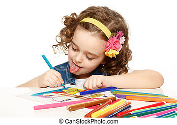 Cheerful little girl with felt-tip pen drawing in kindergarten