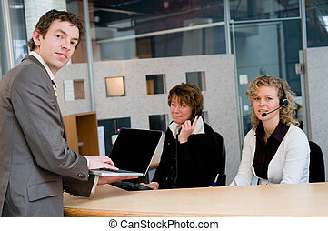 Front desk - Customer waiting at the frontdesk, checking his...