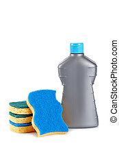 Detergent bottle and sponges reflected on white background....