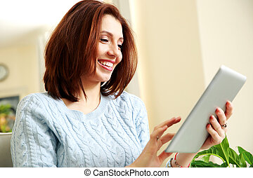 Happiness woman using tablet computer at home