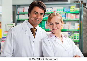pharmacy - portrait of two pharmacists looking at camera and...
