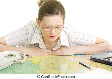 Woman bending over map - Pretty young woman in eyeglasses...