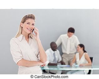 Buiness woman taking on the phone - Business woman on phone...