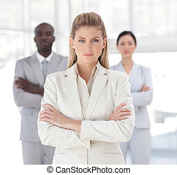 Young Powerful looking business woman looking at camera