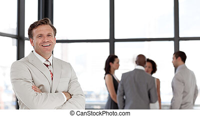 Confident business man in font of business team